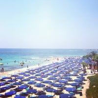 Photo taken at Fig Tree Bay by Arina P. on 7/12/2013