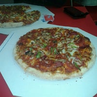 Photo taken at Domino's Pizza by Orhan T. on 12/28/2012