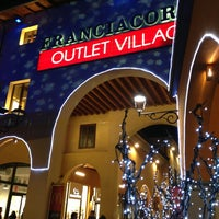 Photo taken at Franciacorta Outlet Village by Marco C. on 12/24/2012