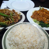 Photo taken at Green Basil Thai Restaurant by Roy H. on 10/26/2012