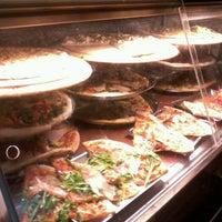 Photo taken at Pizza Poselli by Miranda J. on 3/15/2013