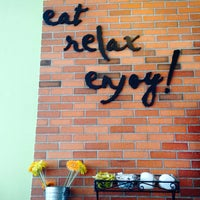 Photo taken at Camilles Sidewalk Cafe by Gyn O. on 5/7/2014