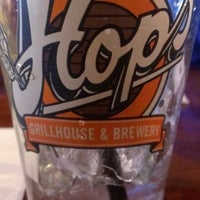 Photo taken at Hops Grill and Brewery by Michelle V. on 11/29/2012