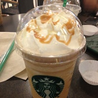 Photo taken at Starbucks by ชุ แ. on 12/25/2012