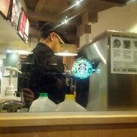 Photo taken at Starbucks by Fabrice V. on 12/30/2012