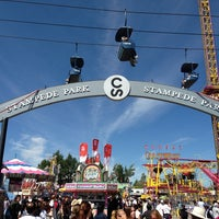 Photo taken at Stampede Park by Sergio Daniel on 7/7/2013