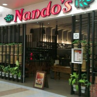 Photo taken at Nando's by Lingesh M. on 12/31/2012