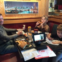 Photo taken at Red Robin Gourmet Burgers by Mimmo on 12/26/2015