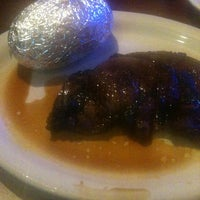 Photo taken at Silver Flame Steakhouse & Seafood by Anna G. on 7/24/2013