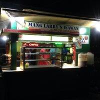 Photo taken at Mang Larry's Isawan by Benjamin T. on 10/6/2013