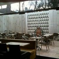 Photo taken at Omonia Cafe by Irina A. on 3/29/2013