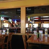 Photo taken at Applebee's Neighborhood Grill & Bar by Joe M. on 5/16/2013