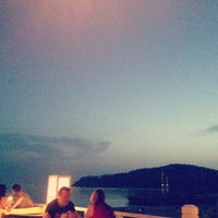 Photo taken at Buzz Beach Bar by Serhan C. on 5/22/2013