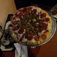 Photo taken at Oggi's Pizza & Brewing Company by Jessica T. on 4/30/2013