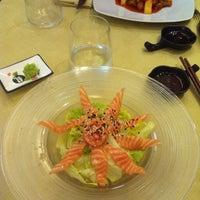 Photo taken at Hong Ye Wok Sushi by Enrica G. on 5/20/2013