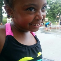 Photo taken at Greenwood St Sprinkler Park by Tscherina T. on 7/18/2013