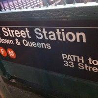 Photo taken at MTA Subway - 23rd St (F/M) by Olesya M. on 1/19/2013