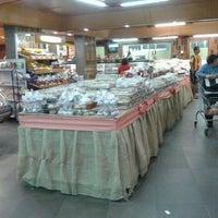 Photo taken at Supermercado Guanabara (Hiper) by Carlinhos M. on 5/5/2013