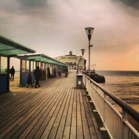 Photo taken at Bournemouth Pier by Diony U. on 3/28/2013
