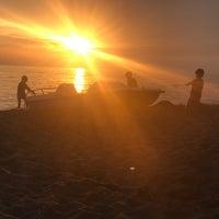 Photo taken at Etruria beach by Philipp S. on 6/14/2017