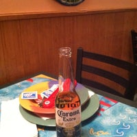 Photo taken at Gilligan's Clam Bar and Grill by Jeannette W. on 4/18/2013