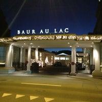 Photo taken at Baur au Lac by Emir R. on 1/2/2013