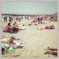Photo taken at Rockaway Beach by Bonnie C. on 8/11/2013