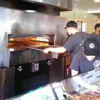 Photo taken at Pieology Pizzeria by Angie C. on 11/25/2012