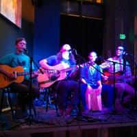 Photo taken at Awaken Cafe by Angie C. on 6/2/2013