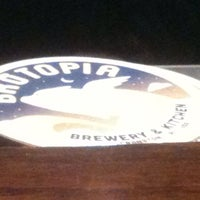 Photo taken at Brutopia Brewery & Kitchen by Wine N. on 5/5/2014