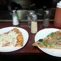 Photo taken at 99¢ Pizza Spot by Pau C. on 4/6/2014
