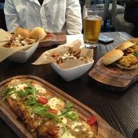 Photo taken at Frolik Kitchen + Cocktails by Melenie Y. on 6/8/2013