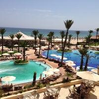 Photo taken at Mövenpick Resort & Marine Spa Sousse by Tim T. on 7/16/2013
