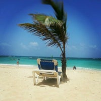 Photo taken at Riu Palace's Beach by André G. on 7/21/2013
