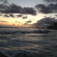 Photo taken at Waikiki Beach Walls by Jered B. on 6/5/2013