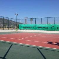 Photo taken at Muğla Büyükşehir Belediyesi Tenis Kortları by Mehmet K. on 7/22/2014