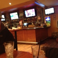 Photo taken at Sporting News Grill by Alexis B. on 12/27/2012