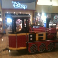 Photo taken at Disney Store by Alinda A. on 2/11/2013