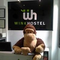 Photo taken at Wink Hostel by Ahman D. on 10/21/2012
