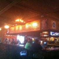 Photo taken at The Lodge Beer and Growler Bar by Kelly C. on 6/28/2013