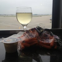 Photo taken at Delta Sky Club by Emily L. on 5/27/2013