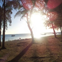 Photo taken at Mont Choisy Beach by Mehzabeen on 5/13/2013