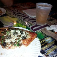 Photo taken at Pizzalley's Pizzeria by Dawn W. on 1/4/2013