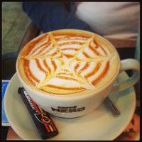 Photo taken at Caffé Nero by Doğakan on 5/17/2013