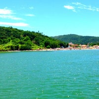 Photo taken at Praia da Cachoeira do Bom Jesus by Juliane R. on 1/13/2013