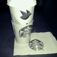 Photo taken at Starbucks by Nai V. on 12/14/2012
