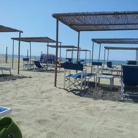 Photo taken at Mama/Dune Beach by Marco C. on 8/9/2013