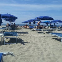 Photo taken at Mama/Dune Beach by Marco C. on 9/7/2013