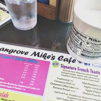 Photo taken at Mangrove Mike's Cafe by Krystal B. on 8/9/2015