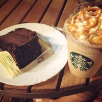 Photo taken at Starbucks by Cristina F. on 6/23/2013